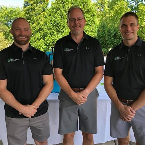 Doctors Posing in Matching Black Shirts and Gray Shorts